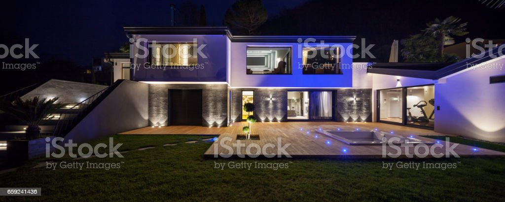 House with pool in the evening, nobody stock photo
