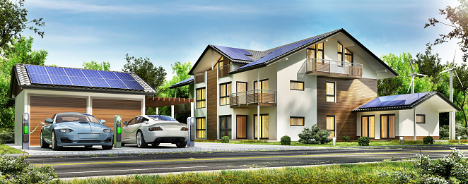 Beautiful house with solar panels on the roof and electric cars on charge. Modern house