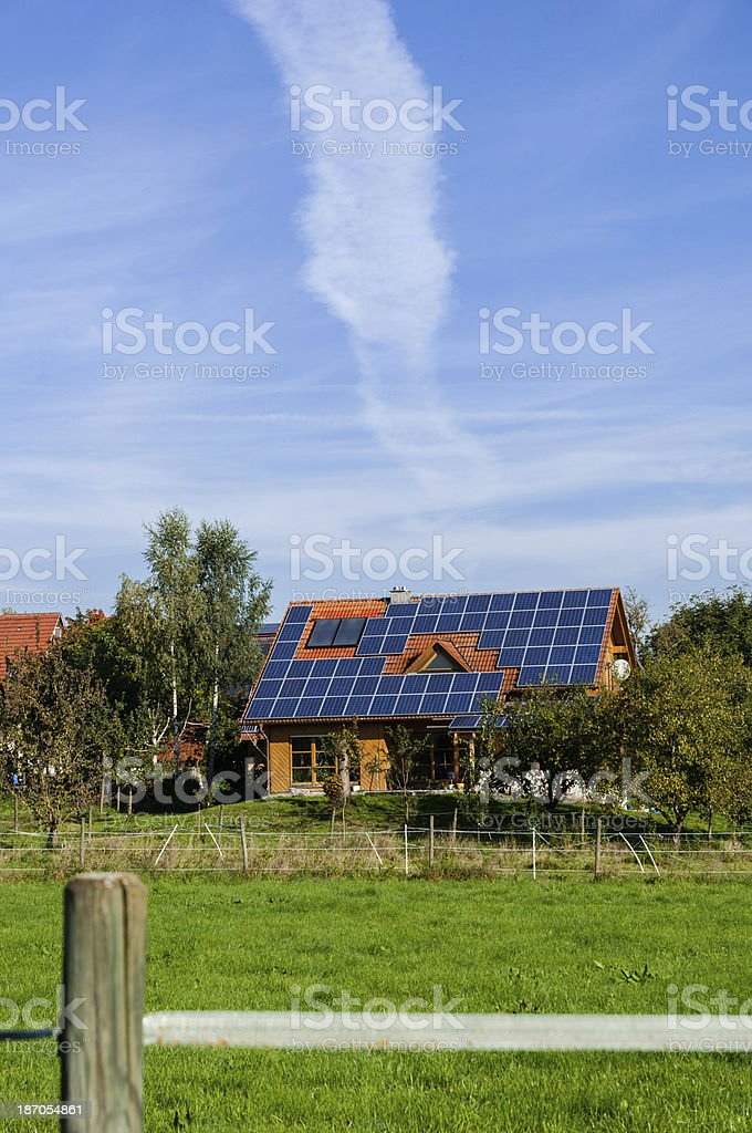 House with solar panels on the roof, rural architecture, Germany stock photo
