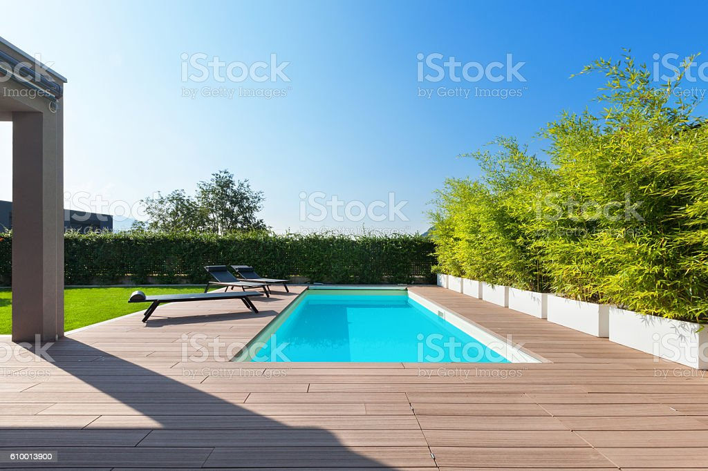 House with swimming pool, outdoors stock photo