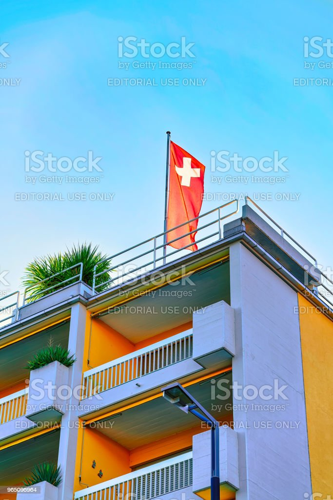 House with Swiss flag in Ascona Ticino in Switzerland CH royalty-free stock photo