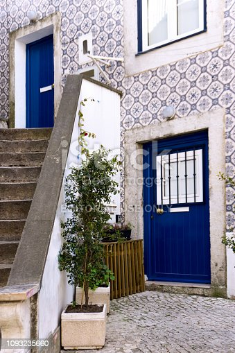 Porto, Portugal: May 13 2018 - House with typical traditional glazed tiles on facade of blue and white color in Lisabon, Portugal