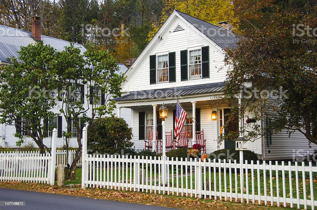 House with white picket fence stock photo