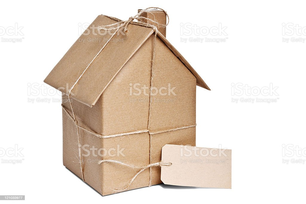 A house wrapped in brown paper and twine stock photo
