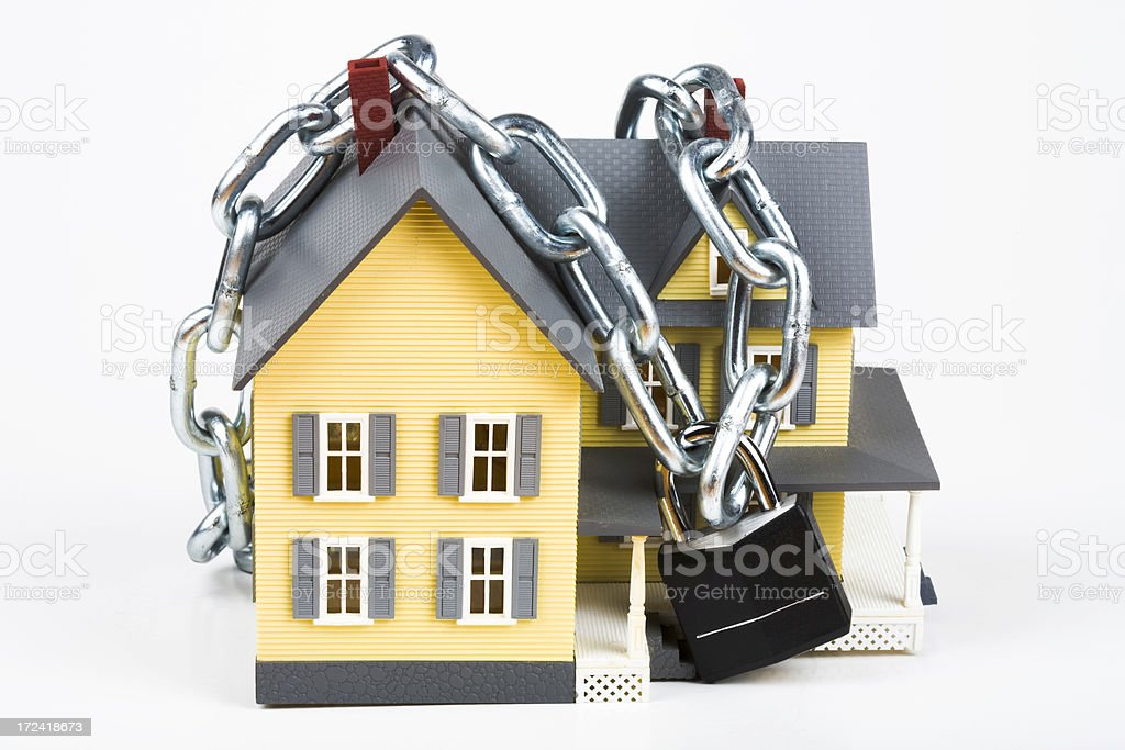 House wrapped in chain royalty-free stock photo