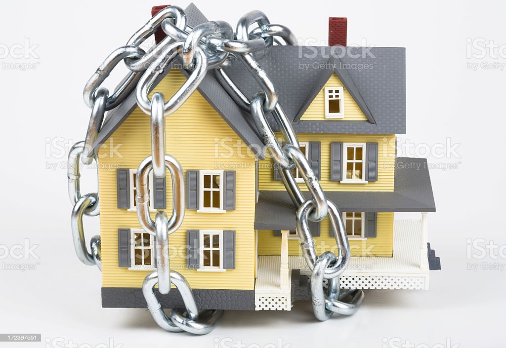 House wrapped in steel chain royalty-free stock photo