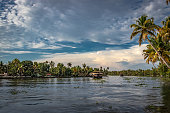Houseboat at backwater with amazing sky and palm tree at morning from flat angle image is taken at alleppey kerala india.