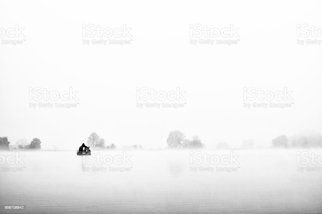 Houseboat at foggy morning stock photo