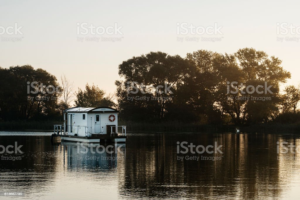 Houseboat floating on water stock photo