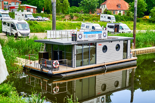 Houseboat for rent in the harbor for use as a vacation home waiting for vacationers in Lauenburg, Germany, June 8., 2021