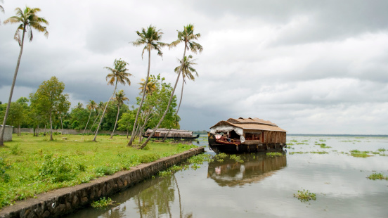 Houseboat In Backwaters On A Cloudy Day Stock Photo - Download Image Now