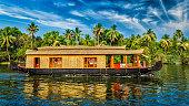 Travel tourism Kerala background - panorama of tourist houseboat on Kerala backwaters. Kerala, India