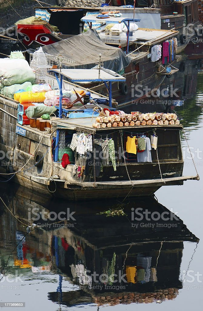 Houseboat refected on water surface stock photo