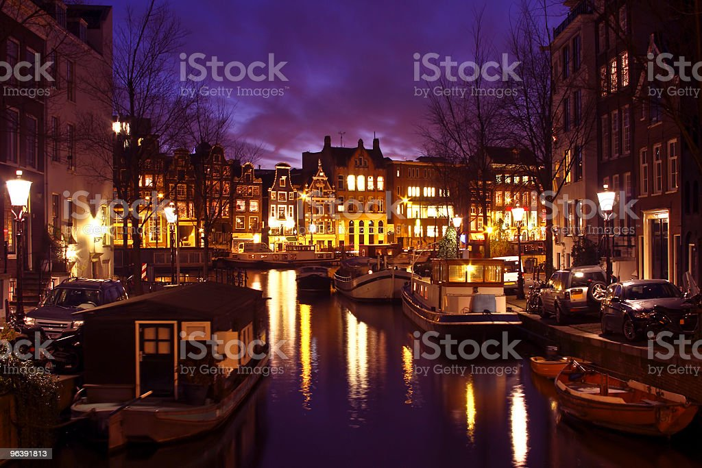 Houseboats and houses at twilight in Amsterdam the Netherlands - Royalty-free Amsterdam Stock Photo