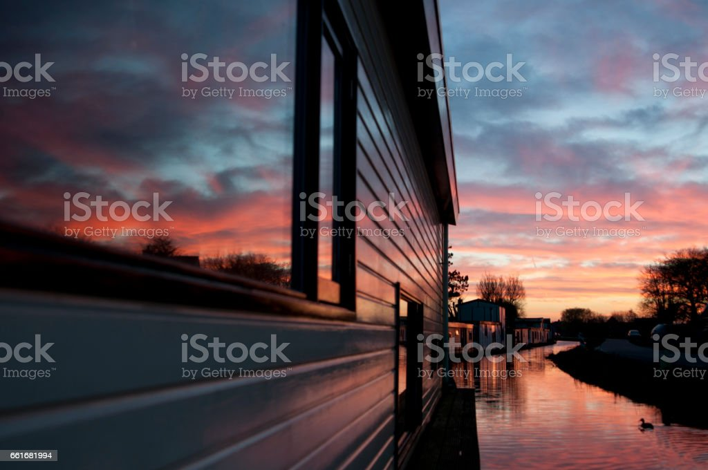 Houseboats in the sunset stock photo