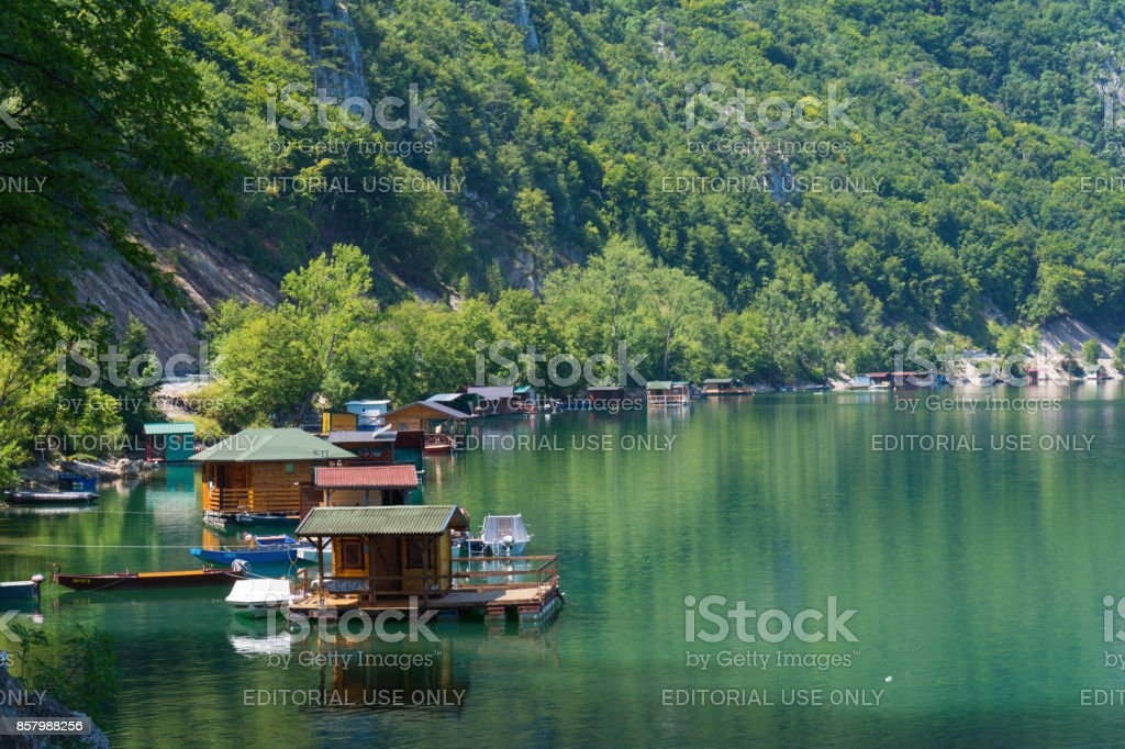 Houseboats of Perucac lake stock photo