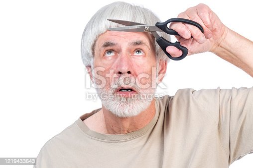 Horizontal shot of a gray haired man who