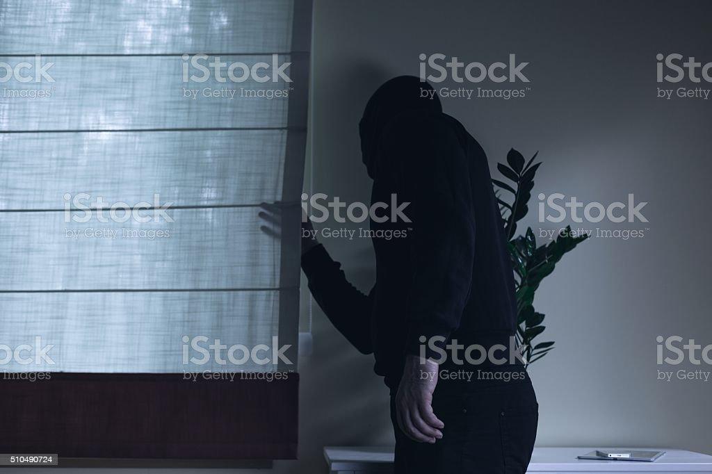 Housebreaker during night home invasion stock photo