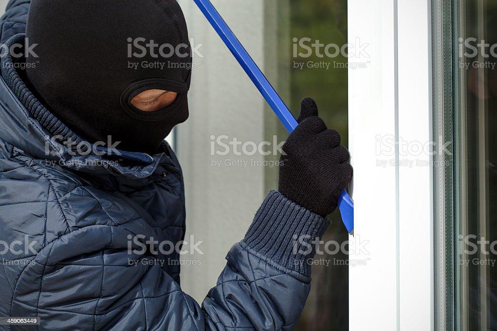 Housebreaker openning the window stock photo