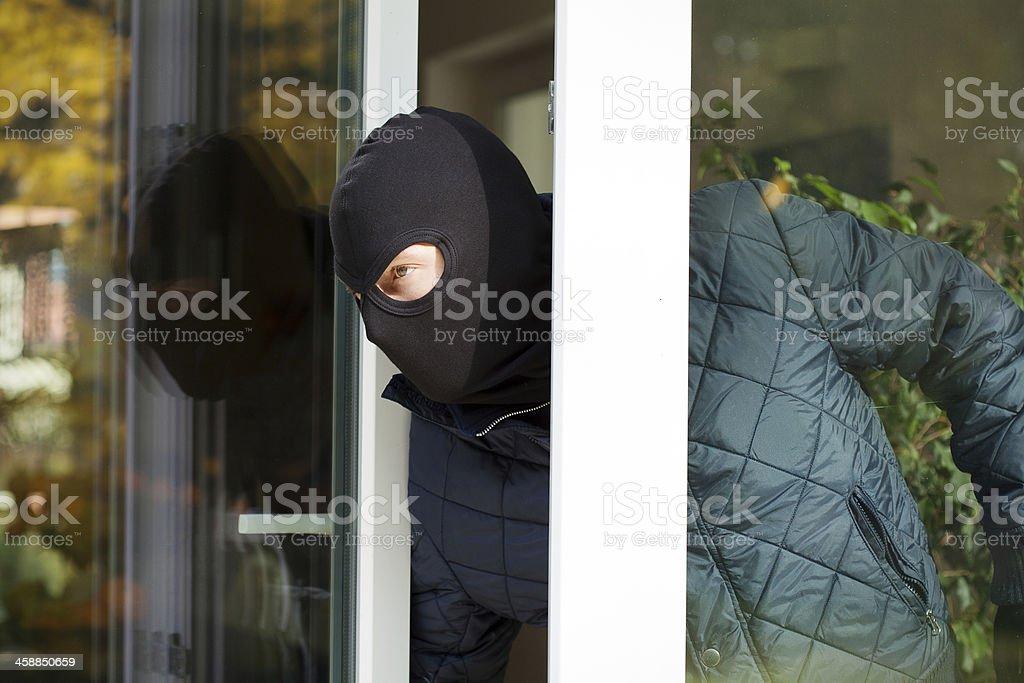 Housebreaker wearing a mask stock photo