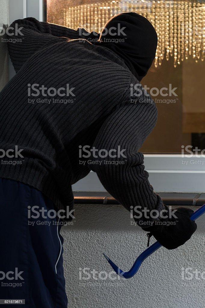 Housebreaker with crowbar stock photo