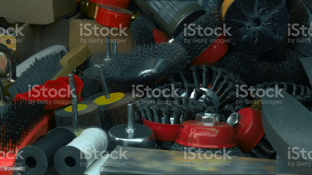 Household appliances. Wire brushes and grindstones stock photo