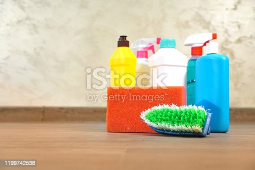 Household chemicals for cleaning service standing on the floor