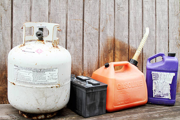 Household hazardous waste products and containers Household hazardous waste products. Gasoline container, propane gas cylinder tank, battery, and plastic chemical solvent container. toxic waste stock pictures, royalty-free photos & images