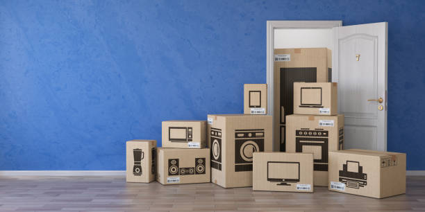 household kitchen appliances and home electronics in cardboard boxes and open door. e-commerce, internet online shopping and delivery concept. - electronics industry stock pictures, royalty-free photos & images