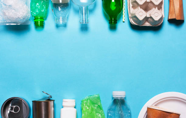 Household waste on a blue background. Household waste on a blue background. The concept of sorting plastic, polyethylene cardboard, paper, glass. Environment protection recycling stock pictures, royalty-free photos & images