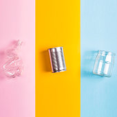 Sorting garbage concept - glass, plastic and iron on different colored backgrounds. Top view, flat lay