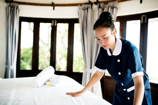 housekeeper cleaning a hotel room - maid stock pictures, royalty-free photos & images