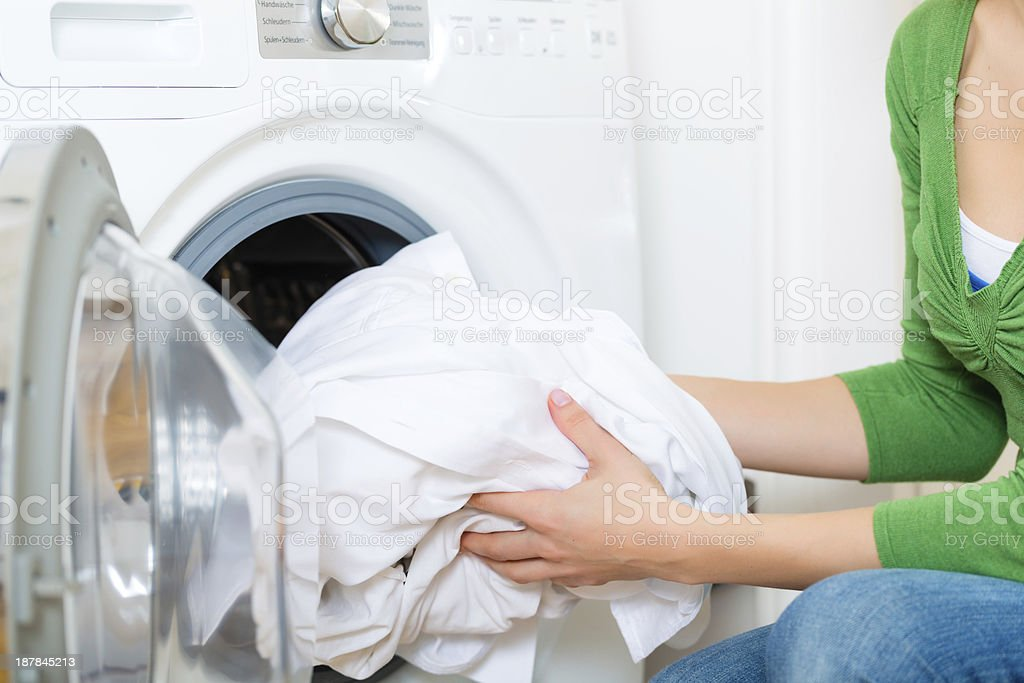 Housekeeper with washing machine stock photo