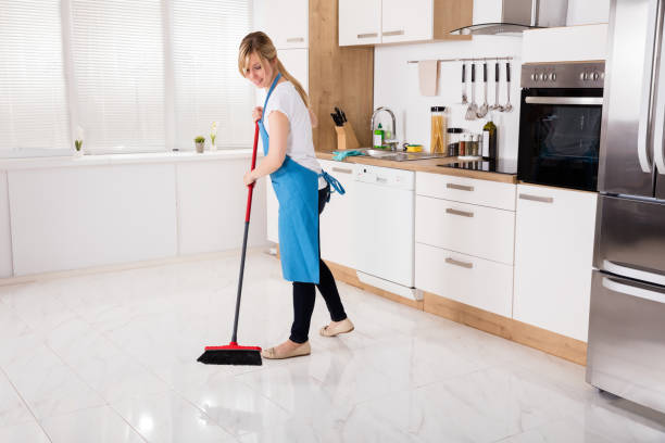 housemaid sweeping floor in kitchen - sweeping stock pictures, royalty-free photos & images