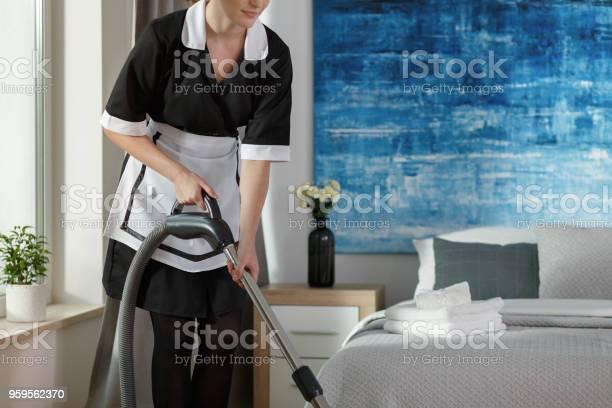Housemaid vacuuming bedroom picture id959562370?b=1&k=6&m=959562370&s=612x612&h=ff0wrduvcdfemgkcvxvatspomg3q4i9nsupkwkvwcik=