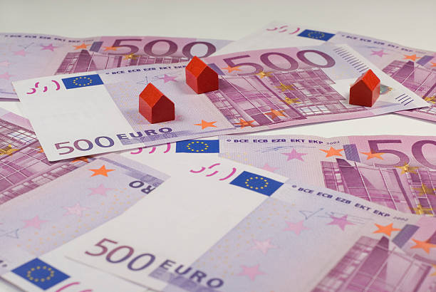 house-money 500 Euro bills and small red wooden houses amortize stock pictures, royalty-free photos & images