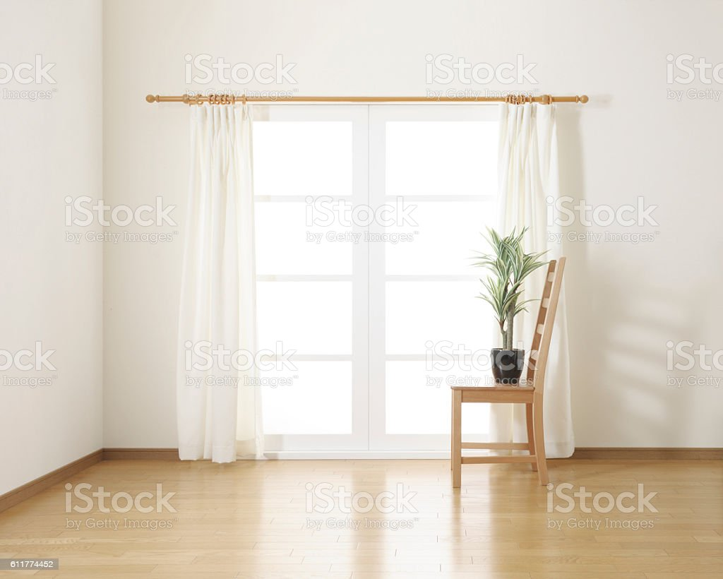 houseplant on wooden chair in white room stock photo