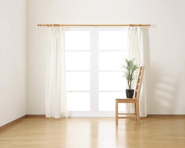 houseplant on wooden chair in white room - gardinen weiß stock-fotos und bilder