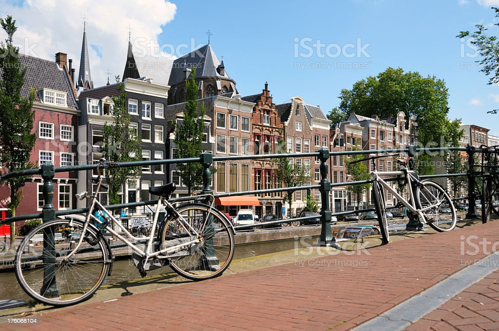 Houses along an Amsterdam canal with bicycles across the way royalty-free stock photo