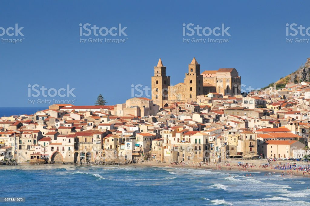 Houses and cathedral in background Cefalu Sicily. stock photo
