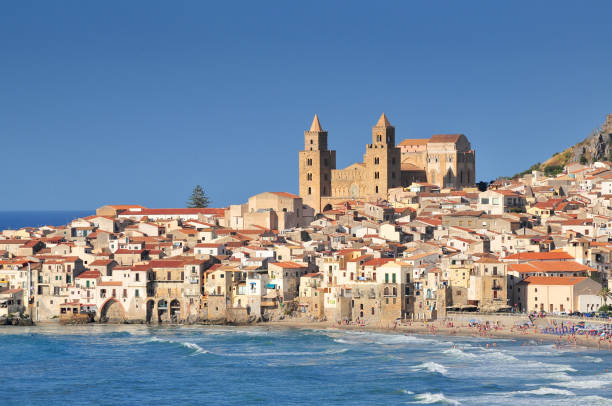 Houses and cathedral in background Cefalu Sicily. - foto stock
