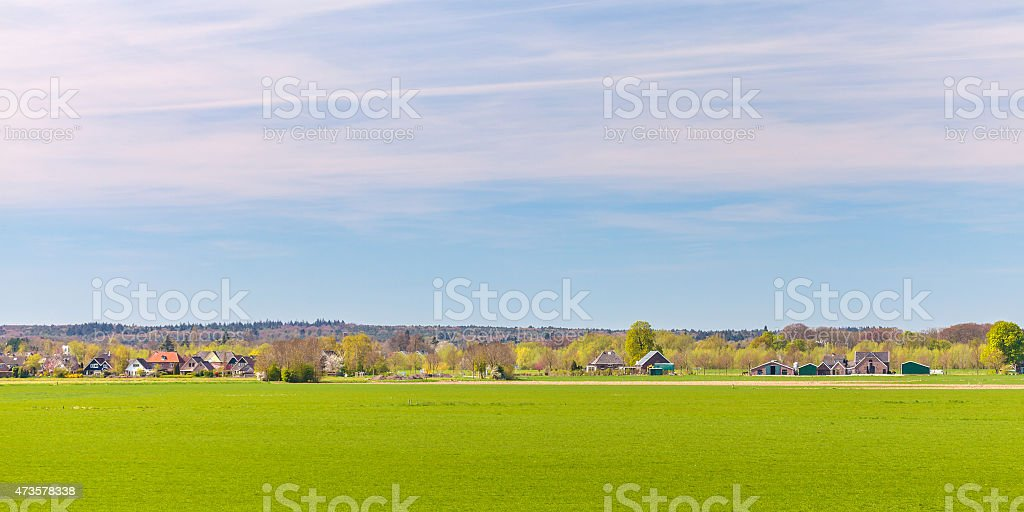 Houses and farms in front of the Dutch park Veluwe stock photo