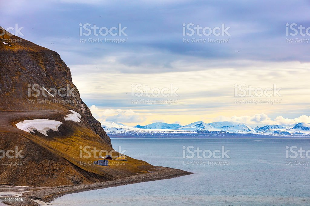 Houses and mountains in arctic summer landscape stock photo