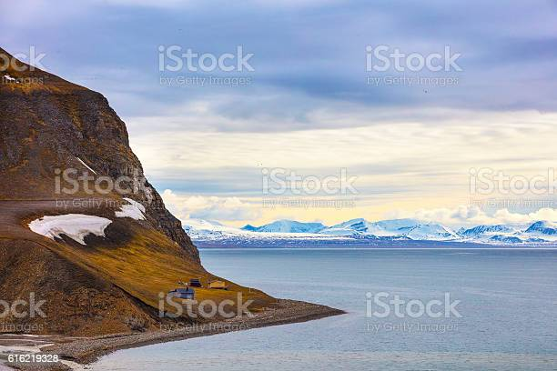 Photo of Houses and mountains in arctic summer landscape