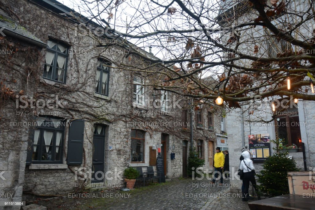 Houses and restaurants with people walking in alley at Durbuy stock photo