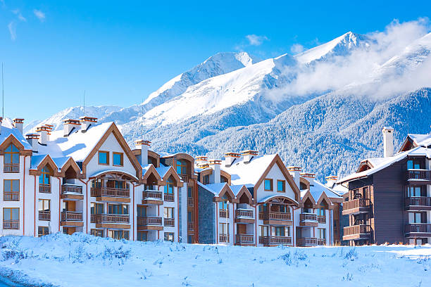 Houses and snow mountains panorama in bulgarian ski resort Bansko Wooden chalet, houses and snow mountains landscape panorama in bulgarian ski resort Bansko, Bulgaria chalet stock pictures, royalty-free photos & images