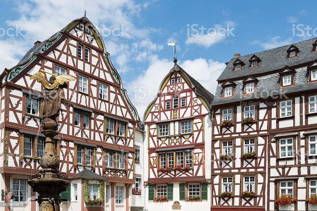 Houses and statue in medieval Bernkastel, Germany stock photo