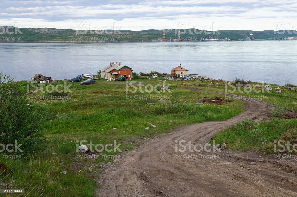 Houses by the water in the village Retinskaya stock photo
