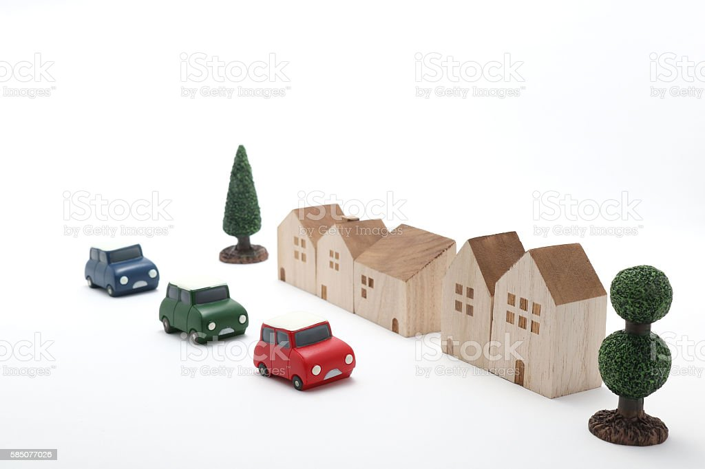 Houses, cars, and trees on white background. stock photo