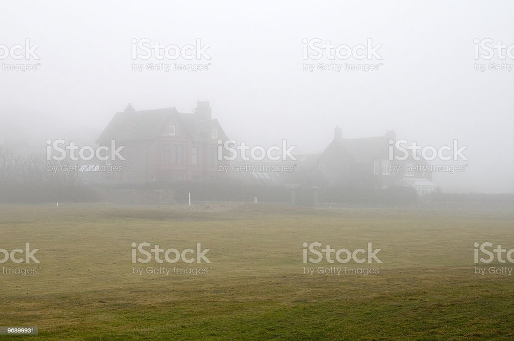 Houses in mist royalty-free stock photo